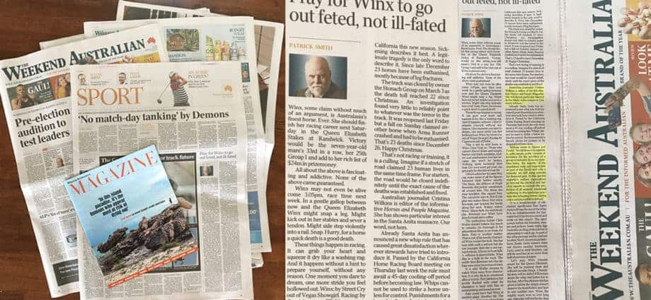 Newspaper, open on table. The Australian Weekend Review. Article about Santa Anita whip reforms.
