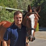 Alistair McLean from the Australian Equine Behaviour Centre with the Standardbred Ideal Guy