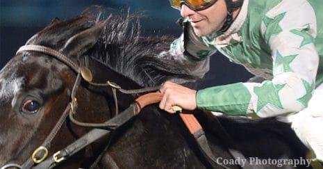 Jigger in use by jockey Roman Chapa by Coady Photography. Jiggers in horse racing