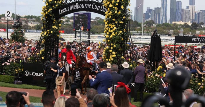 The winner of the 2019 Melbourne Cup, Vow and Declare ridden by Craig Williams surrounded by an admiring public
