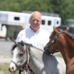 Dr Tom Davis with two of his welsh ponies.