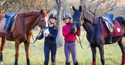 Two girls with their horses. Looking calm. The window of tolerance