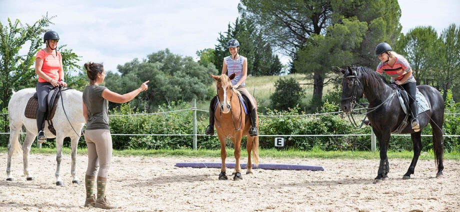 horse riders receiving a lesson