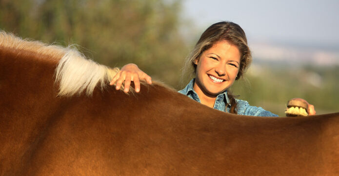 A happy horse owner